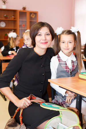 SAINT-PETERSBURG, RUSSIA - September 1: Mother and school-girl in school classroom sitting at a desk Stock Photo - 11063927