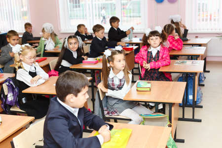 SAINT-PETERSBURG, RUSSIA: September 1, 2011: Russian boys and girls Caucasians students are sitting on the lesson in classroom in school at first September. Editorial