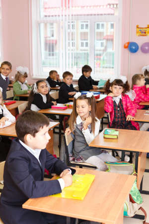 SAINT-PETERSBURG, RUSSIA: September 1, 2011: Russian boys and girls Caucasians students are sitting on the lesson in classroom in school at first September. Stock Photo - 11078967