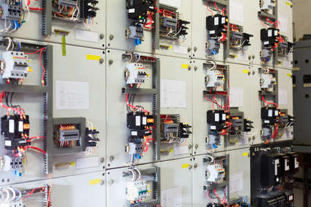 Electric service panel with many switches automatons and breakers Stock Photo