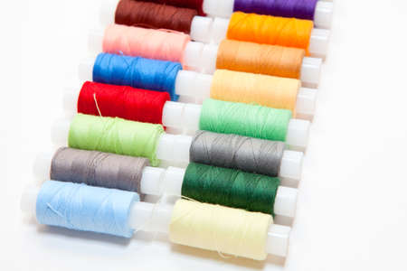 Colourful arranged reel of thread isolated on a white background. photo