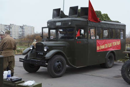 agitation: SAINT-PETERSBURG, RUSSIA – NOVEMBER 4: Military performance in celebration of National Unity Day. Soviet bus with red flags on November 4, 2011 in Saint-Petersburg, Russia.