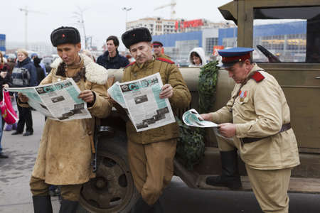 SAINT-PETERSBURG, RUSSIA - NOVEMBER 4: Military performance in celebration of National Unity Day. Three soviet soldiers reading newspapers on November 4, 2011 in Saint-Petersburg, Russia.