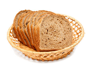 Bread sliced on basket isolated on white background photo