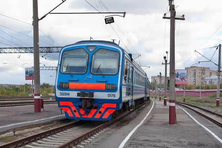 MAGNITOGORSK CITY, RUSSIA - CIRCA SEPTEMBER: Russian suburban electric train on rails in the city on circa September, 2011 in Magnitogorsk city, Russia. Stock Photo - 14277949