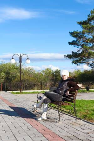 Young beautiful woman sitting alone on a park bench Stock Photo - 11542835