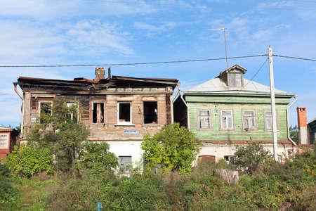NIZHNY NOVGOROD, RUSSIA - SEPTEMBER 24: Old wooden house after fire on September 24, 2011 in Nizhny Novgorod, Russia.