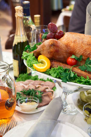 Roast turkey in a dish on the dinner table Stock Photo