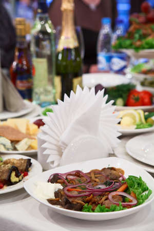 Table appointments with snacks. Plate with fork and knife photo