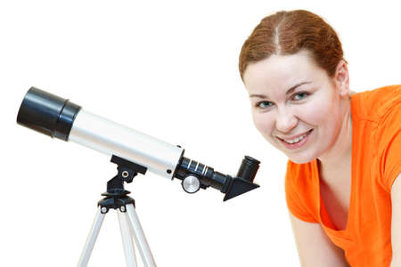 Young woman in orange t-short with telescope isolated on white background photo