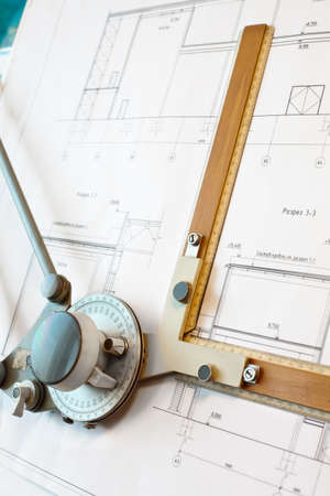 worksite: Old-fashioned dawing board with white project blueprint Stock Photo