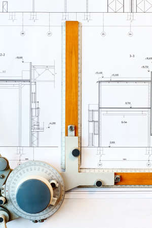 Old-fashioned drawing board with white project blueprint photo