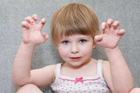 terrifying: Portrait of small girl with terrifying hands up