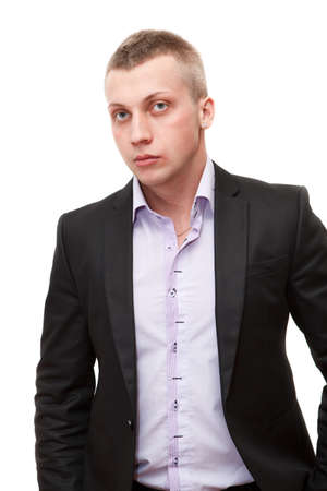 Portrait of young confident business man with blond hair standing on white background photo