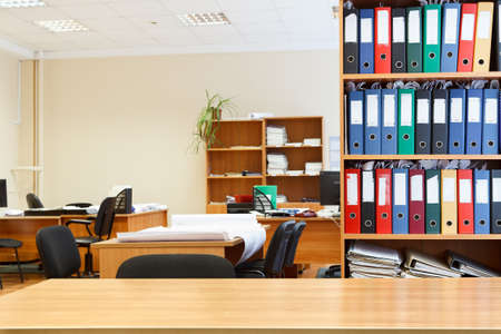 office desk: Modern office interior with tables, chairs and bookcases  Nobody Stock Photo