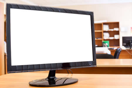 Computer monitor with isolated screen on desktop in office room Stock Photo