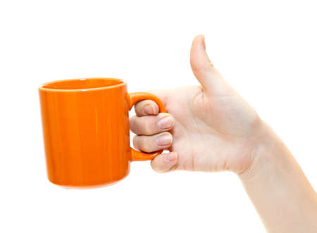 grabbing hand: Female hand with orange teacup isolated on white background Stock Photo