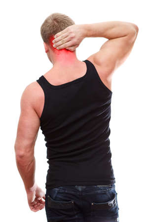 One handsome Caucasian man in black t-shirt with neck pain isolated on white background  photo