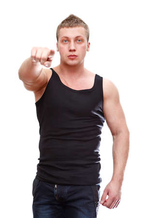 One handsome Caucasian muscular man pointing in black t-shirt isolated on white background  photo