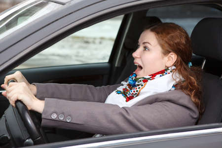 breaks: Pretty young Caucasian woman stopping the car and screaming  Looking forward
