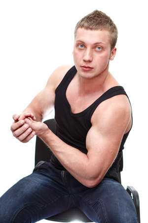 One handsome Caucasian musculan man in black t-shirt isolated on white background photo