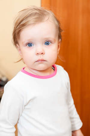Small Caucasian child with blue eyes and blond hair photo