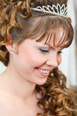 Beauty young Caucasian woman with curly hair and crown on nead Stock Photo - 13817543