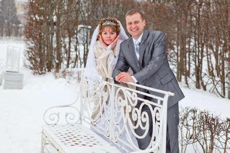 Young wedding Caucasian Russian couple walking on snowy park. Winter season in Russia Stock Photo - 13817584