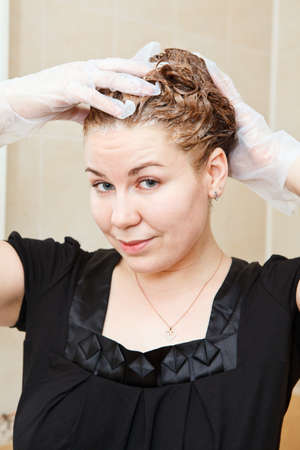 Portrait of pretty Caucasian beautiful woman dyeing hairs at domestic bathroom Stock Photo - 14127106