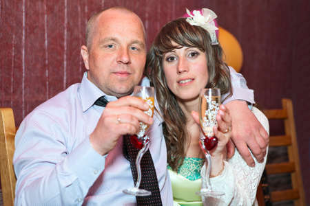 Caucasian man and woman portrait with wineglasses photo