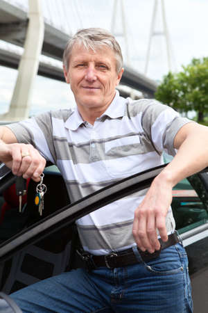 Mature driver with ignition key standing near the car Stock Photo - 14385994
