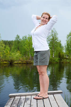 footway: Morning exercises near lake on planked footway Stock Photo
