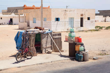 illegal trading: SOUSSE, TUNISIA - CIRCA MAY, 2012: Distribution point of the illegal gasoline on the highway from Tunisia to Libya, on circa May, 2012 in Sousse, Tunisia. Editorial