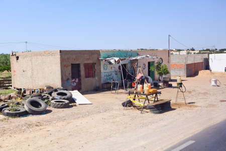 SOUSSE, TUNISIA - CIRCA MAY, 2012: Booth for the illegal trade in gasoline on the highway from Tunisia to Libya, on circa May, 2012 in Sousse, Tunisia. Stock Photo - 15583641