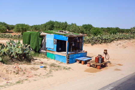 illegal trading: SOUSSE, TUNISIA - CIRCA MAY, 2012: Booth for the illegal trade in gasoline on the highway from Tunisia to Libya, on circa May, 2012 in Sousse, Tunisia.