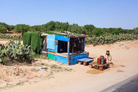 illegal trading: SOUSSE, TUNISIA - CIRCA MAY, 2012: Sales outlet for the illegal trade in gasoline on the highway from Tunisia to Libya, on circa May, 2012 in Sousse, Tunisia. Editorial