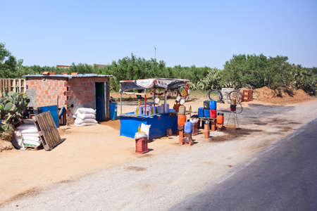 illegal trading: SOUSSE, TUNISIA - CIRCA MAY, 2012: Point of purchase for the illegal gasoline on the highway from Tunisia to Libya, on circa May, 2012 in Sousse, Tunisia.