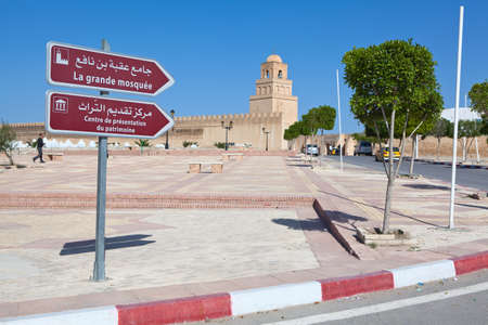 KAIROUAN, TUNISIA - CIRCA MAY, 2012: Direction signs in Arabic and French, to the Great Mosque, on circa May, 2012 in Kairouan, Tunisia.