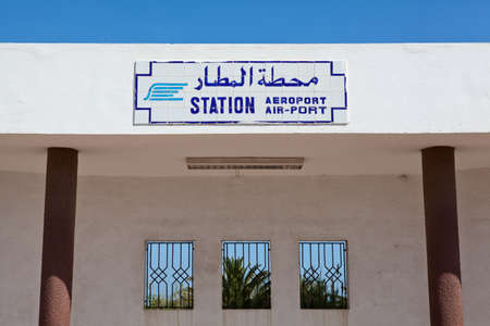 sun roof: MONASTIR, TUNISIA - CIRCA MAY 2012: Rail station plate with title Airport stop on sun roof on circa May, 2012 in Monastir, Tunisia
