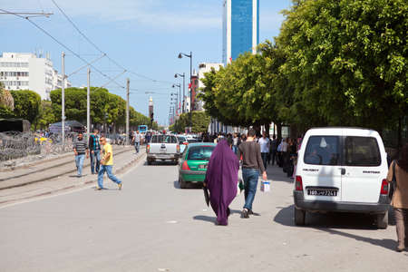 upheaval: TUNIS, TUNISIA - CIRCA MAY, 2012: Main avenue Habib Bourguiba in Tunis capital with people, on circa May, 2012 in Tunis, Tunisia.