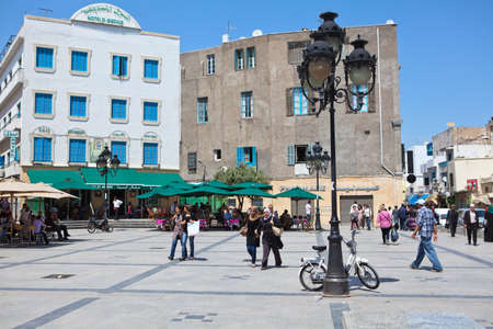 bab: TUNIS CITY, TUNISIA - CIRCA MAY, 2012: Square and Bab Bhar, Porte de France in the center. Cross of Place de la Victoire by the Medina on circa May, 2012 in Tunis city, Tunisia, Africa