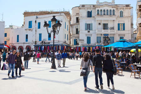 bab: TUNIS CITY, TUNISIA - CIRCA MAY, 2012: Square and Bab Bhar, Porte de France in the center. Cross of Place de la Victoire by Medina on circa May, 2012 in Tunis city, Tunisia, Africa