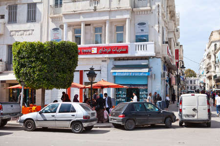 TUNIS, TUNISIA - CIRCA MAY, 2012: The angle of two streets in the city of Tunis capital, on circa May, 2012 in Tunis, Tunisia. Stock Photo - 14720903