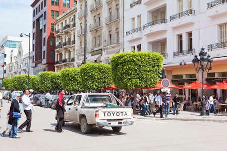 TUNIS, TUNISIA - CIRCA MAY, 2012: Tunisian people walking on the roadside. Habib Bourguiba avenue, on circa May, 2012 in Tunis, Tunisia.