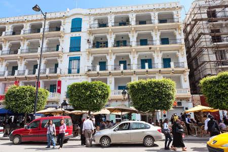 TUNIS, TUNISIA - CIRCA MAY, 2012: Buildings on the streets of capital of Tunisia big Tunis city. Habib Bourguiba avenue, on circa May, 2012 in Tunis, Tunisia. Stock Photo - 14720895