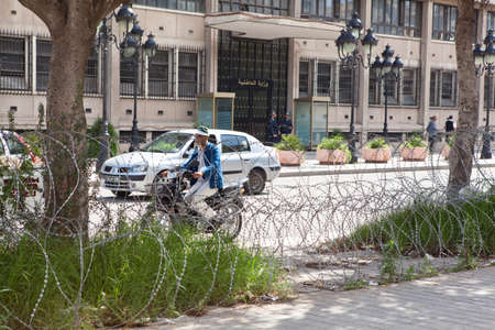 TUNIS, TUNISIA - CIRCA MAY, 2012: The barbed wire that separates the roadway and the pedestrian side of the road, on circa May, 2012 in Tunis, Tunisia. Stock Photo - 14720889