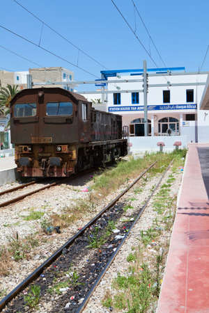 SOUSSE, TUNISIA - CIRCA MAY, 2012: Central railway station with ancient locomotive in the town, on circa May, 2012 in Sousse, Tunisia. Stock Photo - 14720328