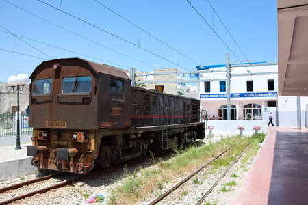 SOUSSE, TUNISIA - CIRCA MAY, 2012: Ancient rusty locomotive in central railway station in the town, on circa May, 2012 in Sousse, Tunisia. Stock Photo - 14720327