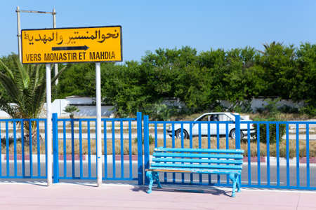 MONASTIR, TUNISIA - CIRCA MAY, 2012: A plate indicating the direction in Monastir and Mahdia in Arabic and French at the railway station, on circa May, 2012 in Monastir, Tunisia. Stock Photo - 14685697