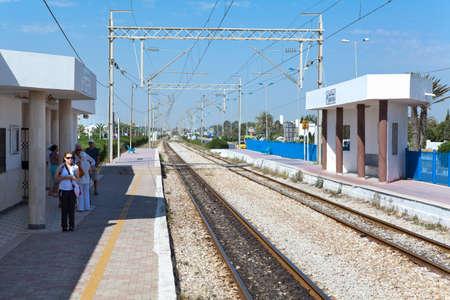 MONASTIR, TUNISIA - CIRCA MAY, 2012: Tourists stand in railway Habib Bourguiba Airport station and waiting intercity train arrival, on circa May, 2012 in Monastir, Tunisia. Stock Photo - 14685711
